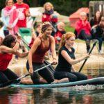 Colorgame Wettkampf auf SUP bei SOMMERJUNG, dem Ferienlager für Erwachsene